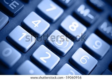 Buttons of calculator toned in blue colo - stock photo