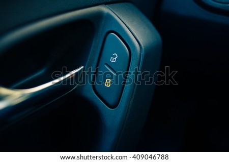 Buttons of central lock in the car - stock photo