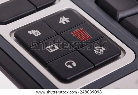Buttons on a keyboard, selective focus on the middle right button - Bin - stock photo