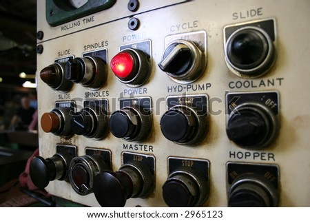 Buttons on a metal working machine. - stock photo
