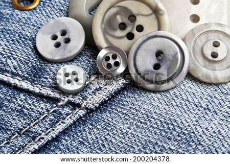 Buttons on denim - stock photo