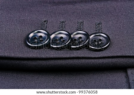 Buttons on the sleeve of jacket. Close-up Photos - stock photo