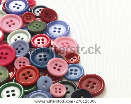 Buttons on white cotton background
