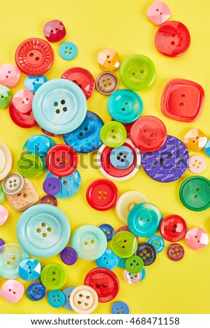 Buttons on yellow paper background
