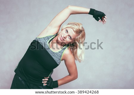 Buxom sporty fitness woman stretching body - stock photo