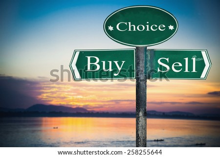 Buy and Sell directions. Opposite traffic sign. - stock photo