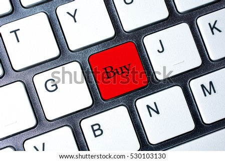 Buy button on white computer keyboard