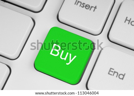 Buy green button on the keyboard close-up