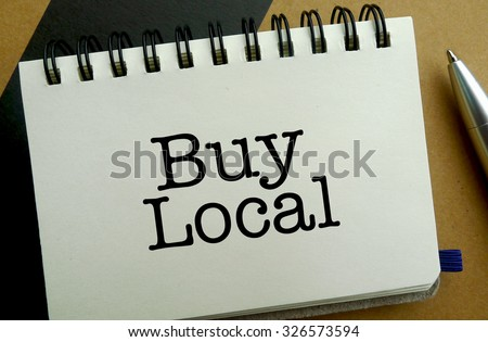Buy local memo written on a notebook with pen