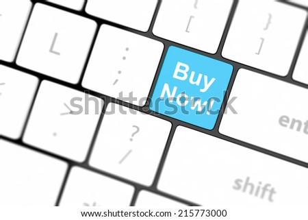 Buy now key on a white keyboard - stock photo