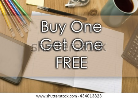 Buy One Get One FREE - business concept with text - horizontal image