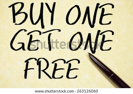 buy one get one free text write on paper  - stock photo