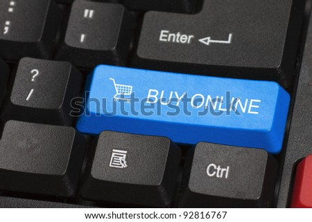 Buy online word on blue and black keyboard button - stock photo
