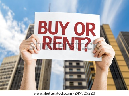 Buy or Rent? card with a urban background - stock photo