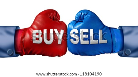 Buy or sell stocks or shares in a business as a boxing match in the symbolic financial ring of investing as two gloves fighting for trading direction in the stock market isolated on white. - stock photo