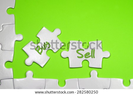 Buy Sell word on white puzzle - Business Concept - stock photo