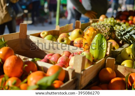 Buying and selling. Colorful background from many different fruits at a farmers market - stock photo