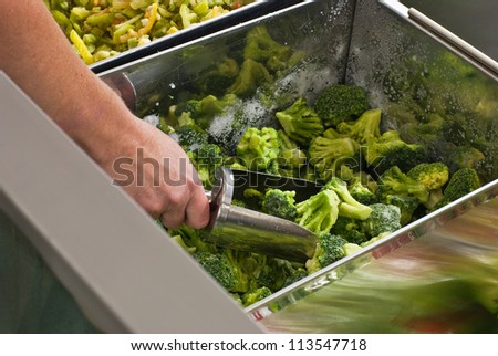 Buying frozen vegetables in  supermarket - stock photo