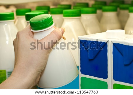 Buying milk in a supermarket - stock photo