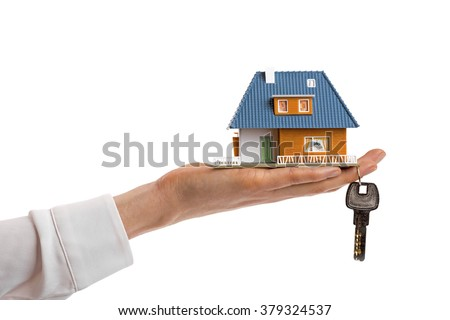 buying new real estate concept, small family house and key on woman's hand