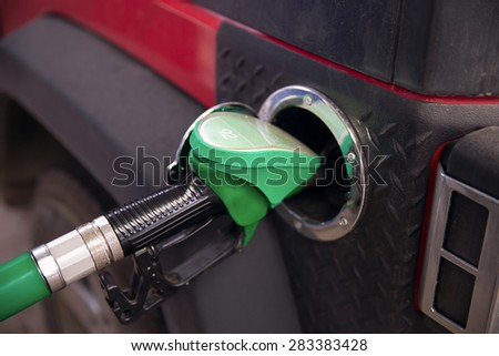 Buying petrol fuel - stock photo