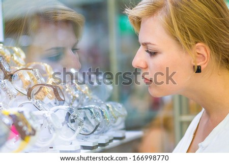 Buying watches at the store - stock photo