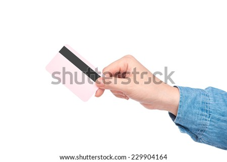 Buying with Credit Card. Hand of customer giving credit card to cashier at checkout  - stock photo