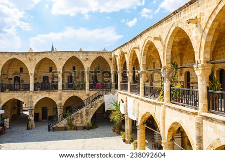 Buyuk Han (The Great Inn) Nicosia, North Cyprus. Ancient Ottoman architecture. Antique arch building. - stock photo