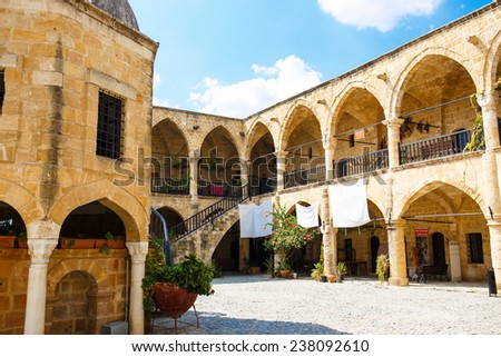 Buyuk Han (The Great Inn) Nicosia, North Cyprus. Ancient Ottoman architecture. Antique arch buildings. - stock photo