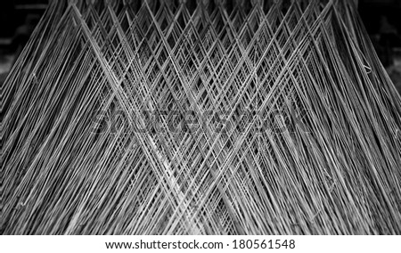 BW pattern from threads in an old spinnery  - stock photo