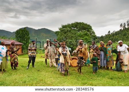 BWINDI NATIONAL PARK, UGANDA- MARCH 25: Batwa pigmy dancers dance the ethnic dances March 25, 2009 in Bwindi National Park, Uganda. Pigmy people are ancient dwellers in the forests. - stock photo