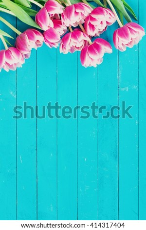 by The baking man in Photos  Abstract  Pink peony tulips on vintage blue background with copy space. Post card, gift card template. Wedding, birthday, spring and summer concept. Vertical composition - stock photo
