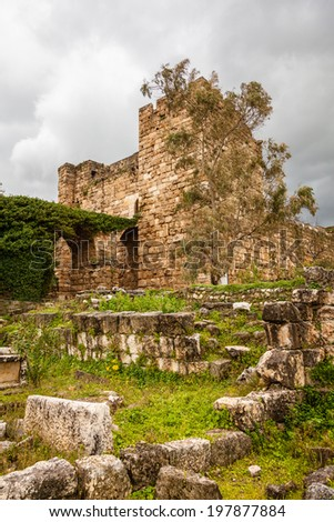 Byblos castle was built by the Crusaders in the 12th century from indigenous limestone and the remains of Roman structures. / Byblos Castle Ruins. - stock photo