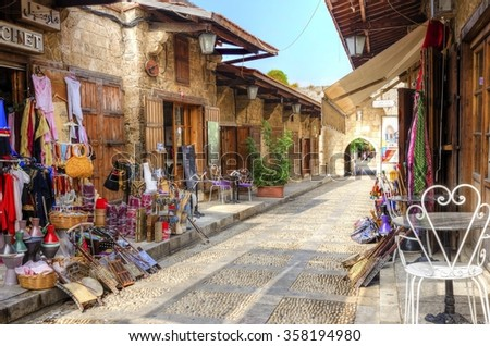 BYBLOS, LEBANON - 13 August, 2013: A view of the old pedestrian souk in Byblos, Lebanon during the day. A very medieval and picturesque area,  paved with little stones and with little shops. - stock photo