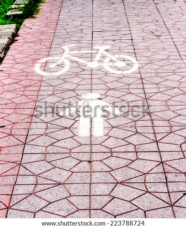 bycicle path on sidewalk in thailand: improve poor lighting and composition - stock photo