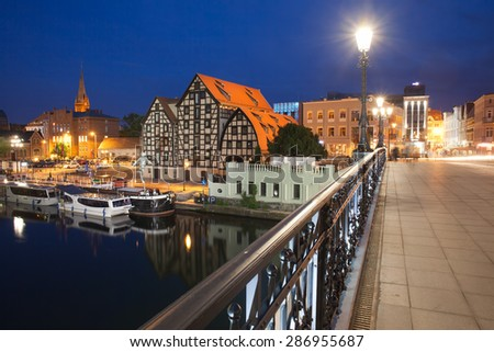 Bydgoszcz city skyline at night in Poland with old Granaries by the Brda River.