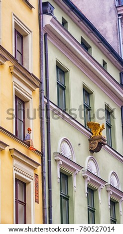 Bydgoszcz, Poland, Colourful facade of old historical tenement house. very narrow street and lamp light on stairs.