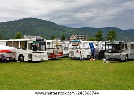 Byglandsfjord, Norway - June 8, 2014: The Norwegian way of camping with restyled coaches used as campers in Byglandsfjord, Norway.