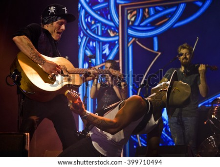 BYRON BAY, AUSTRALIA - MARCH 25 : Nahko and Medicine For The People plays on the Mojo stage at the 2016 Byron Bay Bluesfest. 27th annual Blues and Roots festival. - stock photo