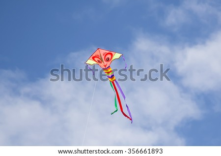 Byron Bay, Australia â?? November 03, 2015: Colorful Kite Flying in blue spring sky at beach of Byron Bay