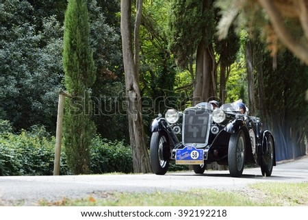 C. BERARDENGO (SI), ITALY - SEPTEMBER 19: A dark green Singer Le Mans takes part in the GP Nuvolari classic car race on September 19, 2015 near C. Berardengo. The car was built in 1934. - stock photo