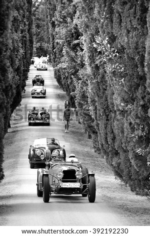 C. BERARDENGO (SI), ITALY - SEPTEMBER 19: An Alvis 12/70 followed by a row of classic cars takes part in the GP Nuvolari race on September 19, 2015 near C. Berardengo. The Alvis was built in 1937. - stock photo