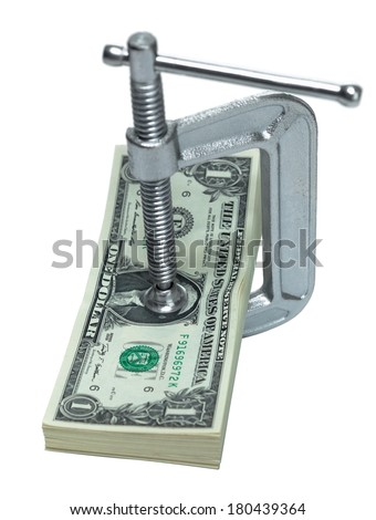 C-clamp on stack of dollar bills, tight on cash - stock photo
