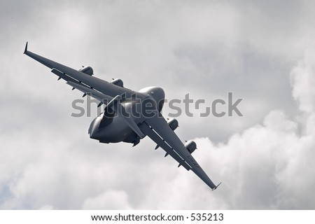 C-17 in flight - stock photo