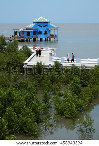CA MAU, VIET NAM- JULY 16, 2016: Group of tourist travelling Dat Mui, a geography place people walking on breakwater along the beach