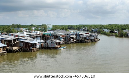 CA MAU, VIET NAM- JULY 16, 2016: Waterway at Mekong Delta, life on Nam Can river, poor residential with house make from metal sheet among mangrove forest, Camau, Vietnam