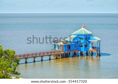 Ca Mau, Vietnam - April 7th, 2015: Floating restaurant on bay with a restaurant guide sea jetties Ca Mau Makes brilliant cape house in bays where the southern end spare fatherland in Ca Mau, Vietnam