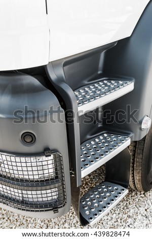 cab of the truck with the stage and the spotlight. Focus on the spotlight