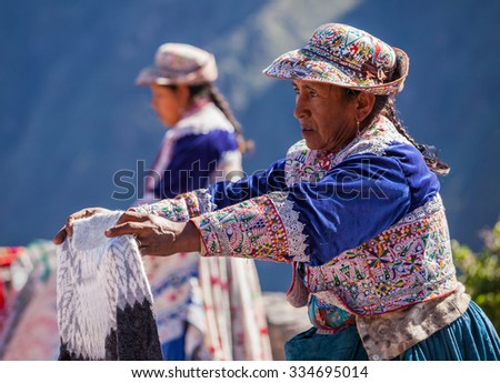 CABANACONDE, PERU - MAY 13, 2015: Unidentified women selling souvenirs at Cruz Del Condor viewpoint.