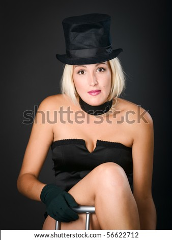Cabaret show woman is sitting on bar chair